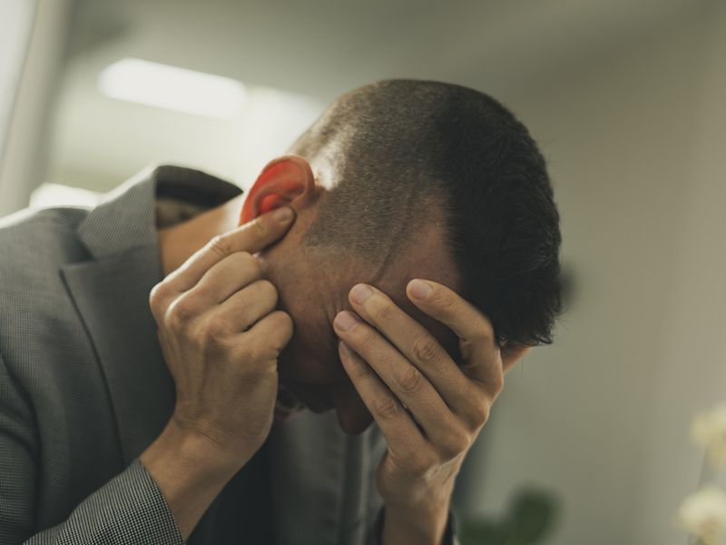 Man suffering from ringing in the ears reads about new research into the causes of tinnitus.