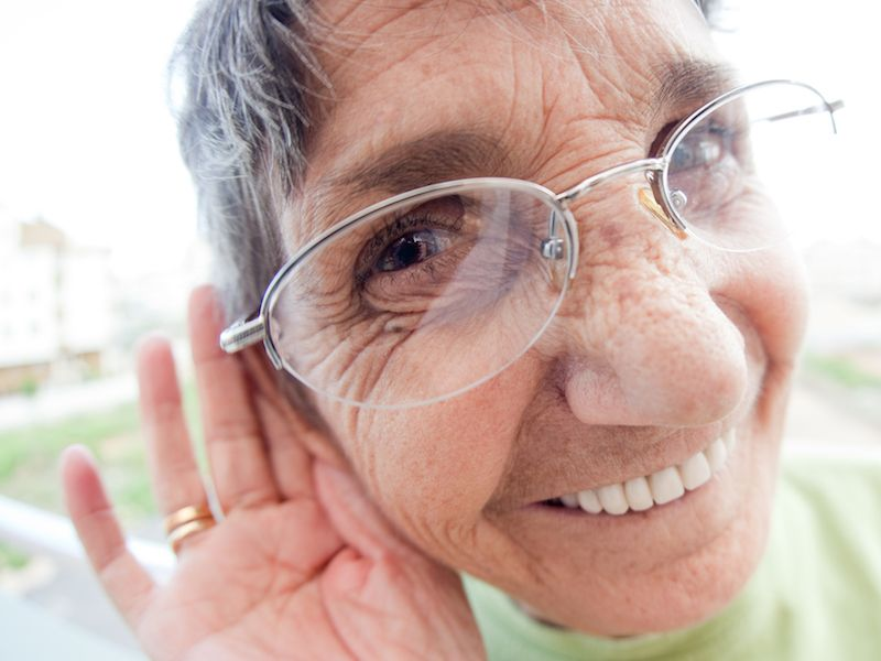 Woman struggling to hear without her hearing aids.