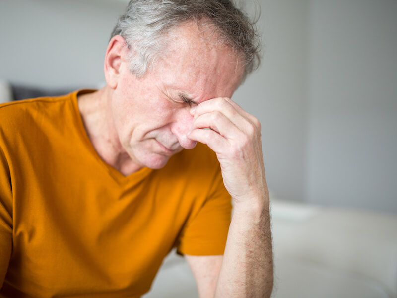 Man with chronic sinus infections thinks about getting balloon sinuplasty from an ENT.