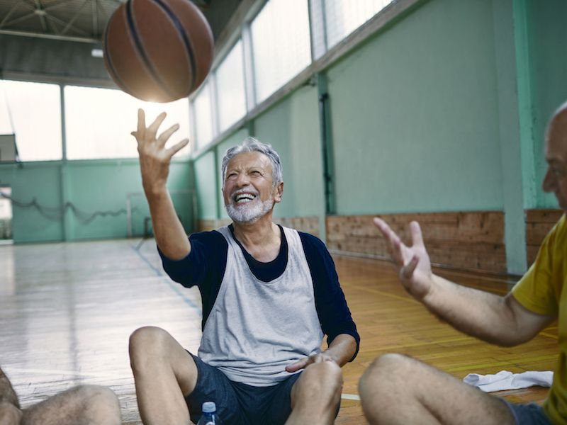 Man playing basketball wonders whether he needs new hearing aids to keep up with his active lifestyle.