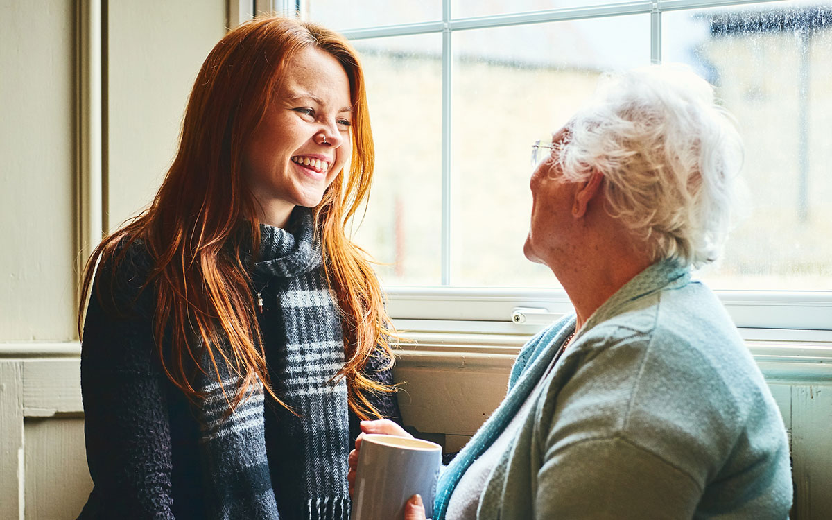 Woman talking to her grandmother about hearing test.